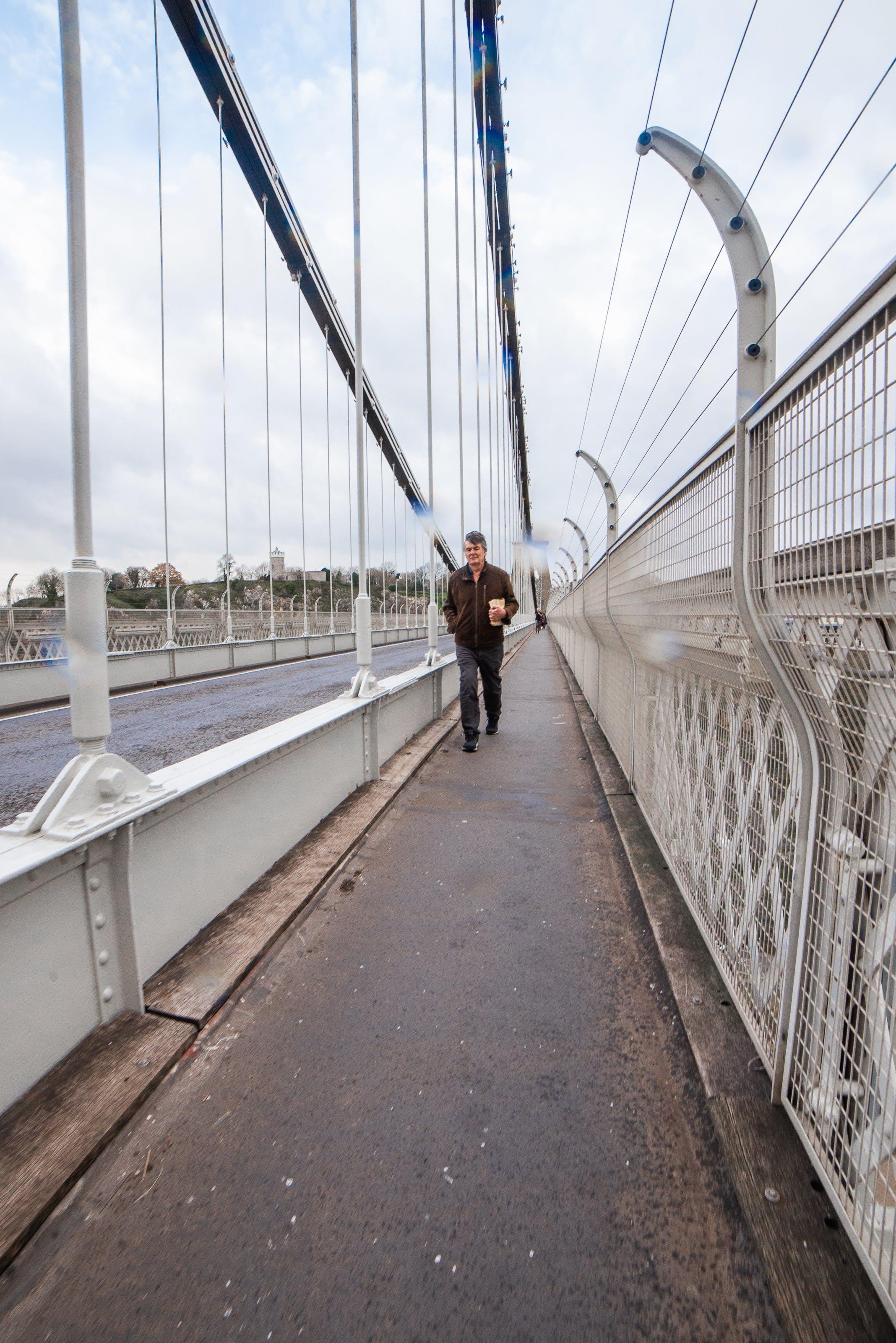 Free stock photo of blue sky, bridge, elderly man, footpath