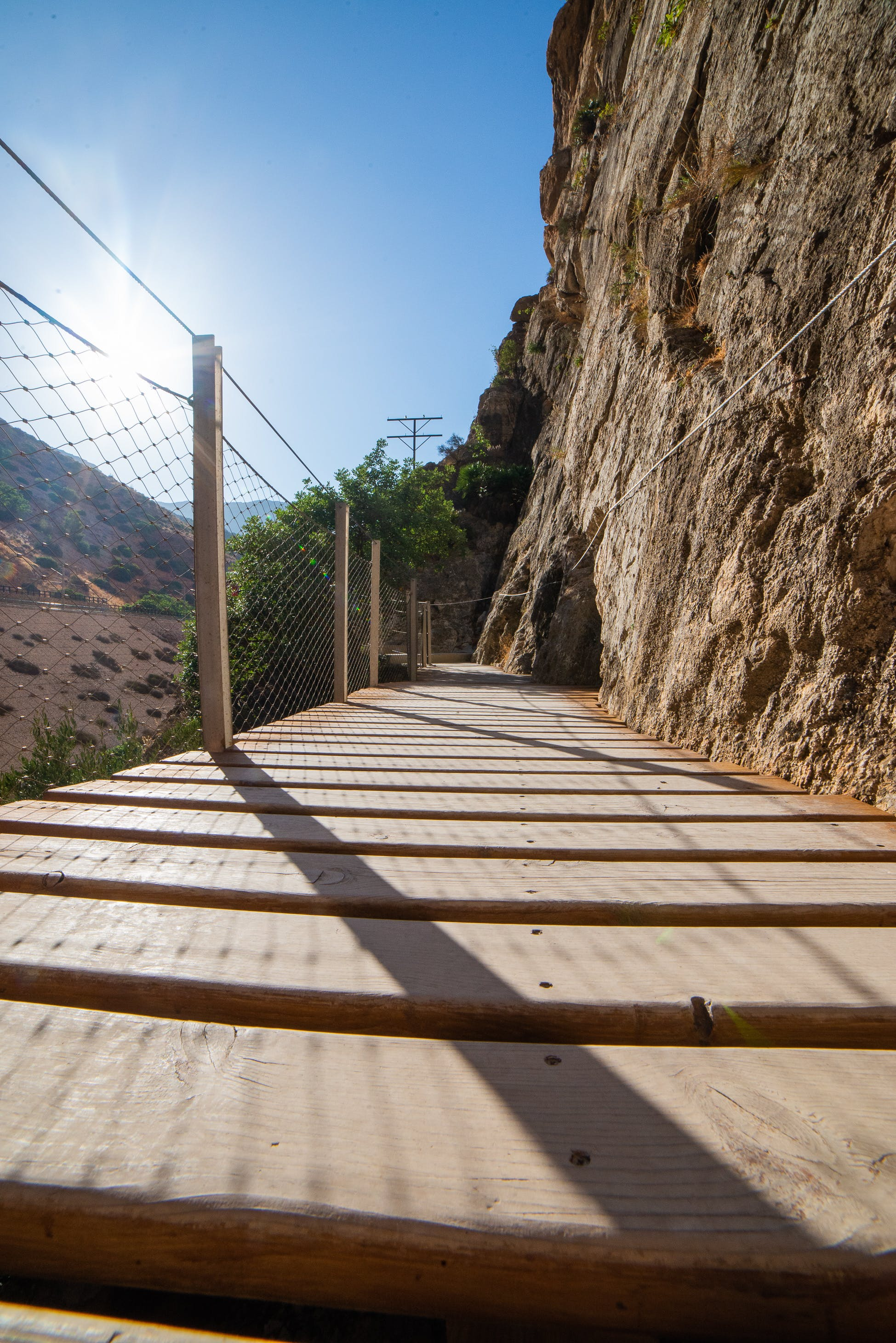 Free stock photo of barriers, footpath, golden sun, rocky mountain