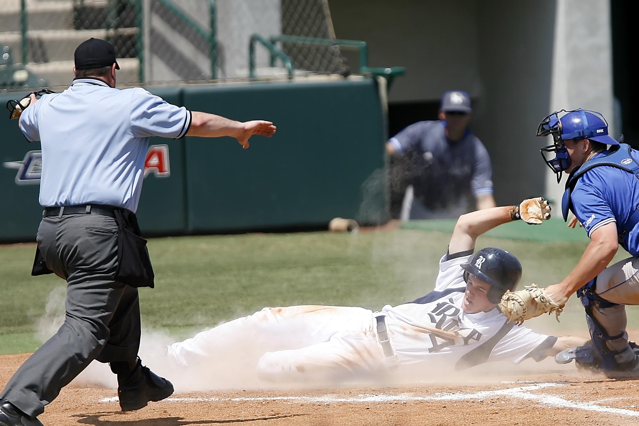 Man With White T Shirt Running to Baseball Home