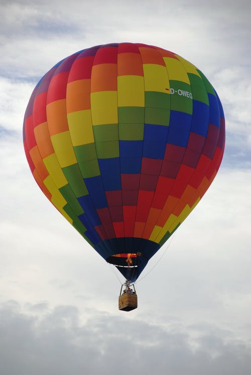 Multi Colored Hot Air Balloon's Grown Shot during Daytime