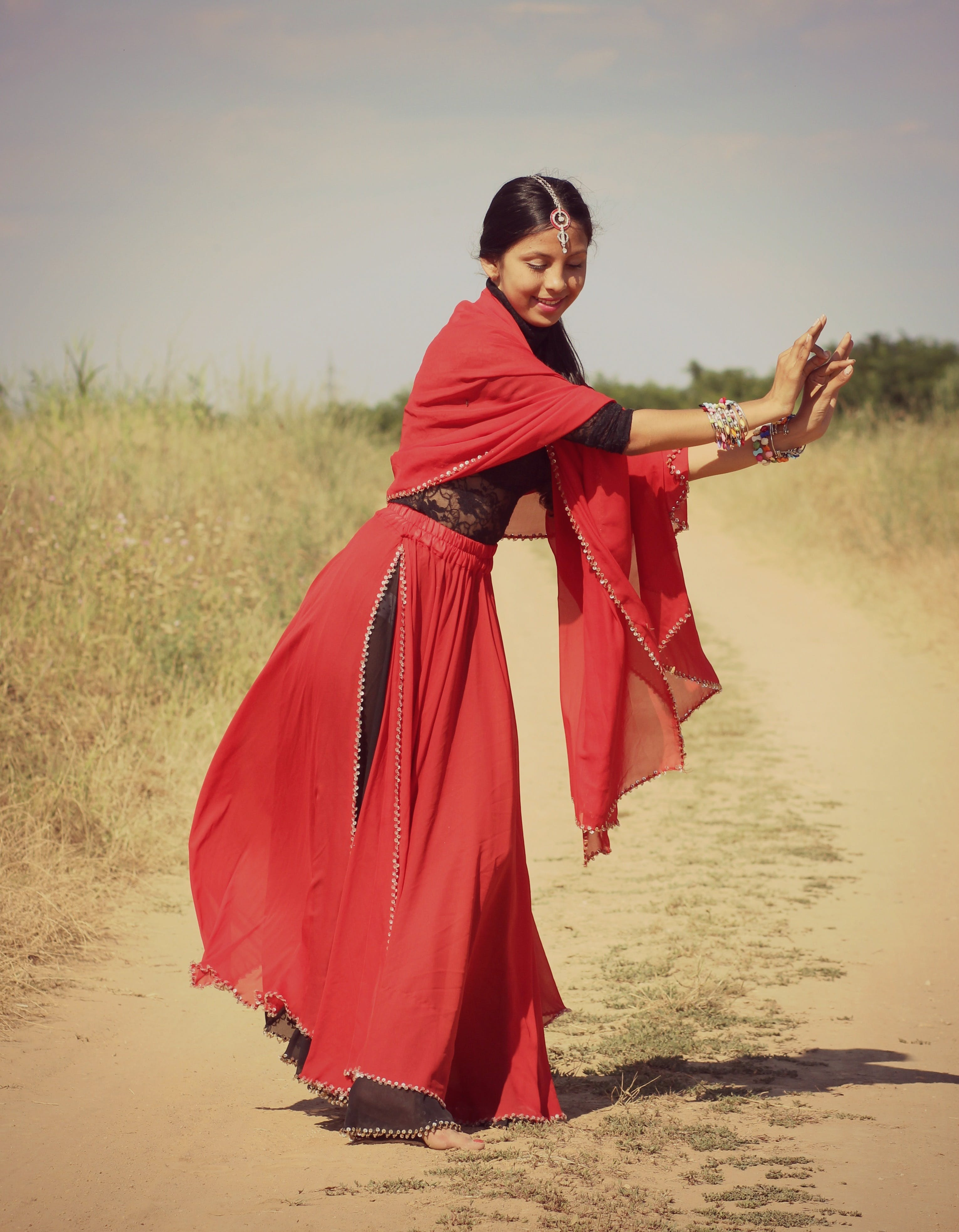 Woman in Red and Black 3/4 Sleeve Dress Dancing