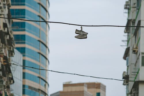 Pair of Shoe on Street Electric Cable