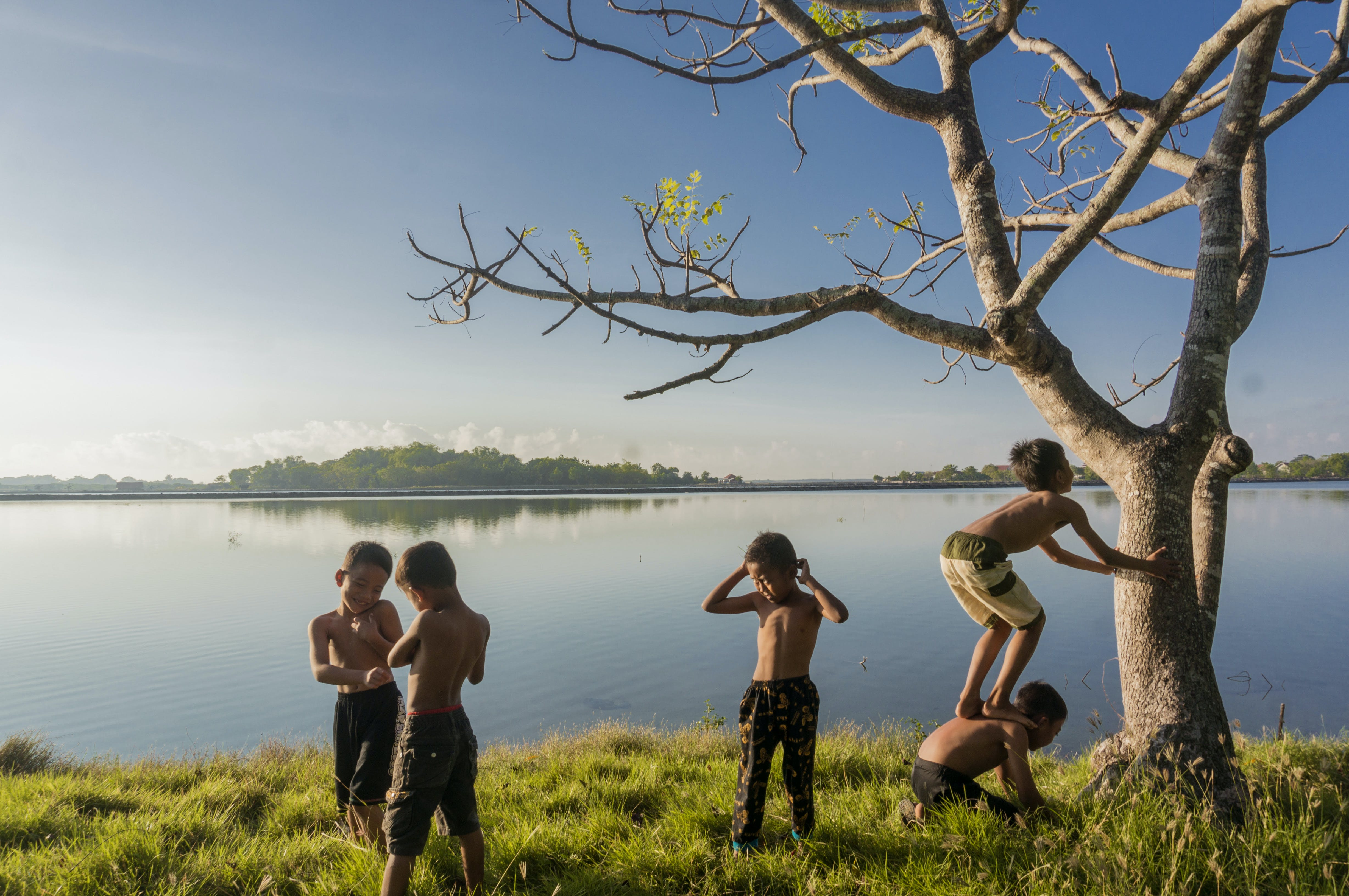 Five Boys Standing Near Body of Water