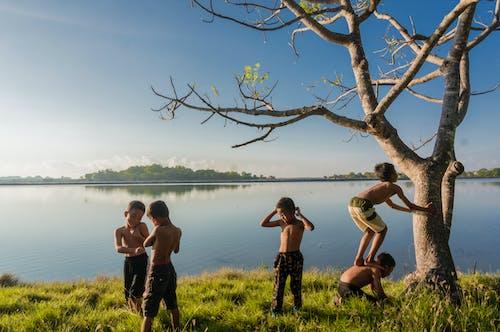 Five Boys Standing Near Body of Water