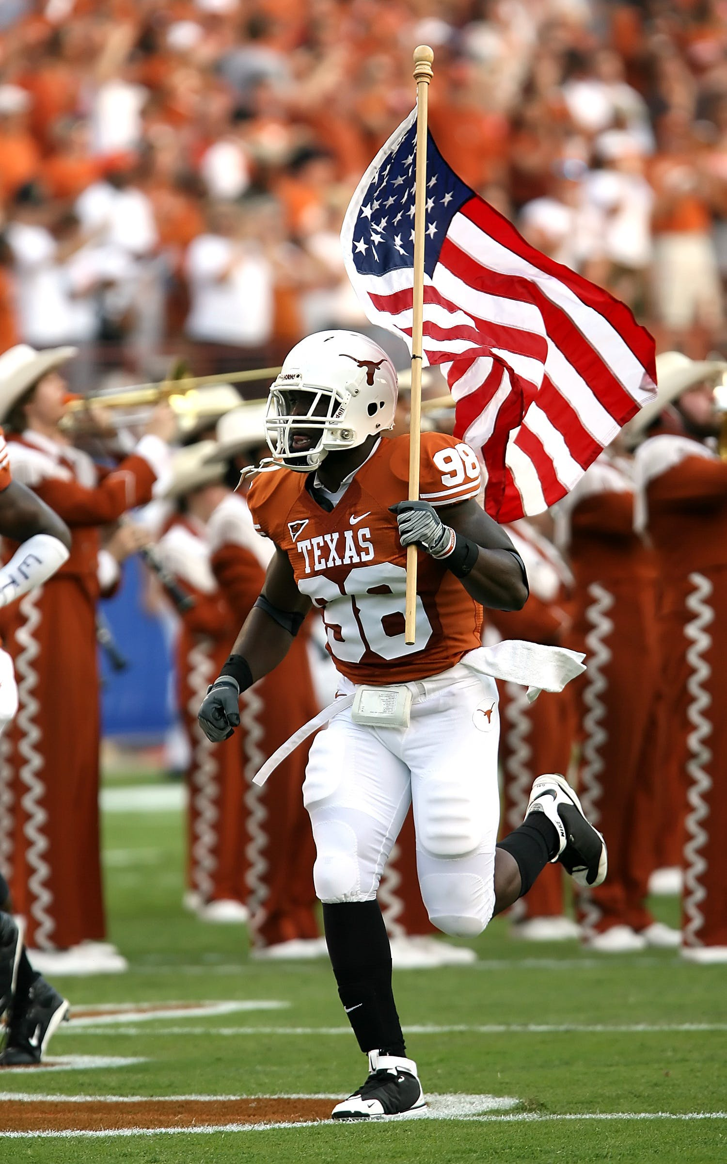 Nfl Player Holding U.s.a. Flag on Field
