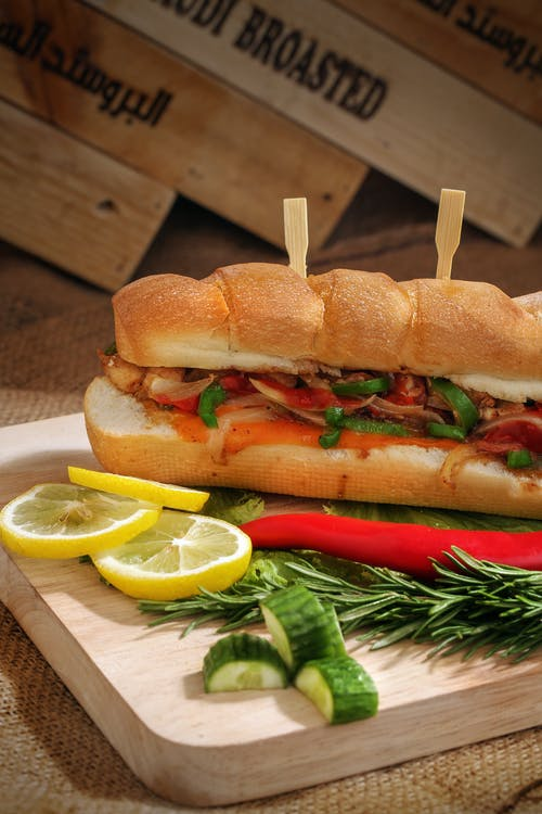 Sliced Baked Bread and Vegetables on Chaffing Board