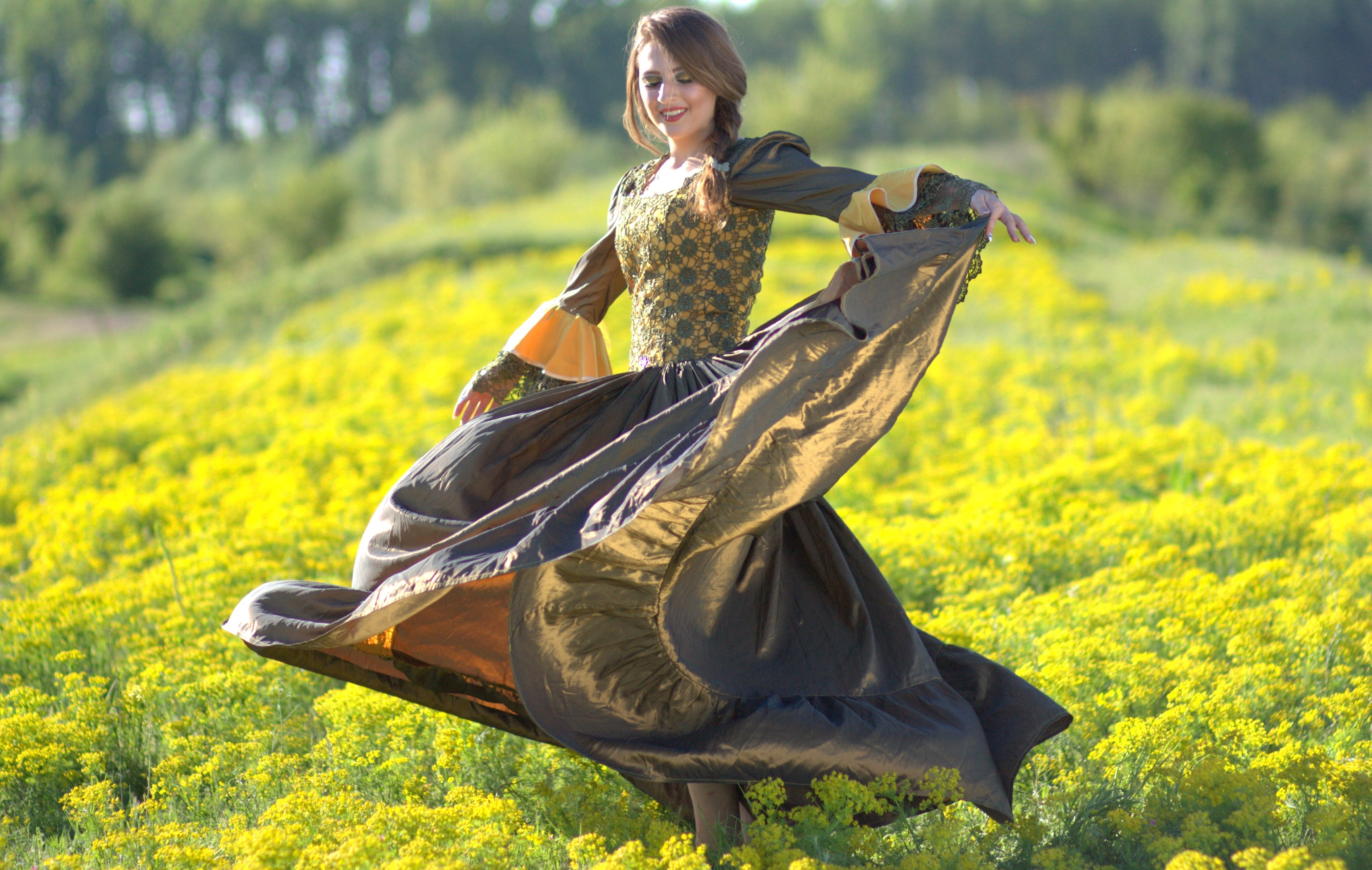 Woman on Princess Costume Waving Her Dress on Green Flower Fields