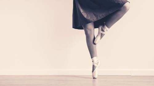 Person in Brown Skirt Doing Ballet