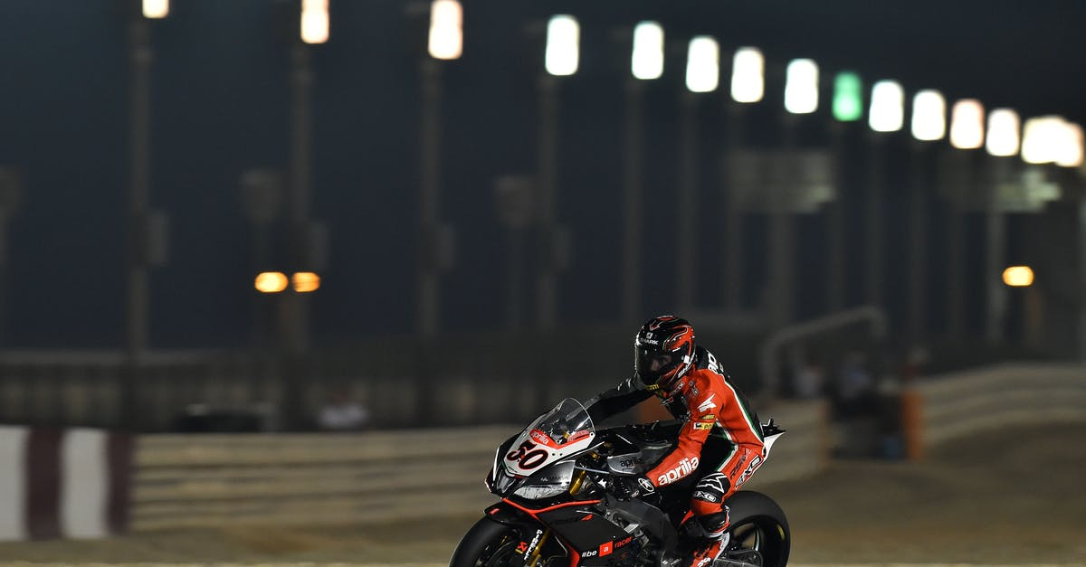 Person Riding Super Bike During Night Race 183 Free Stock Photo