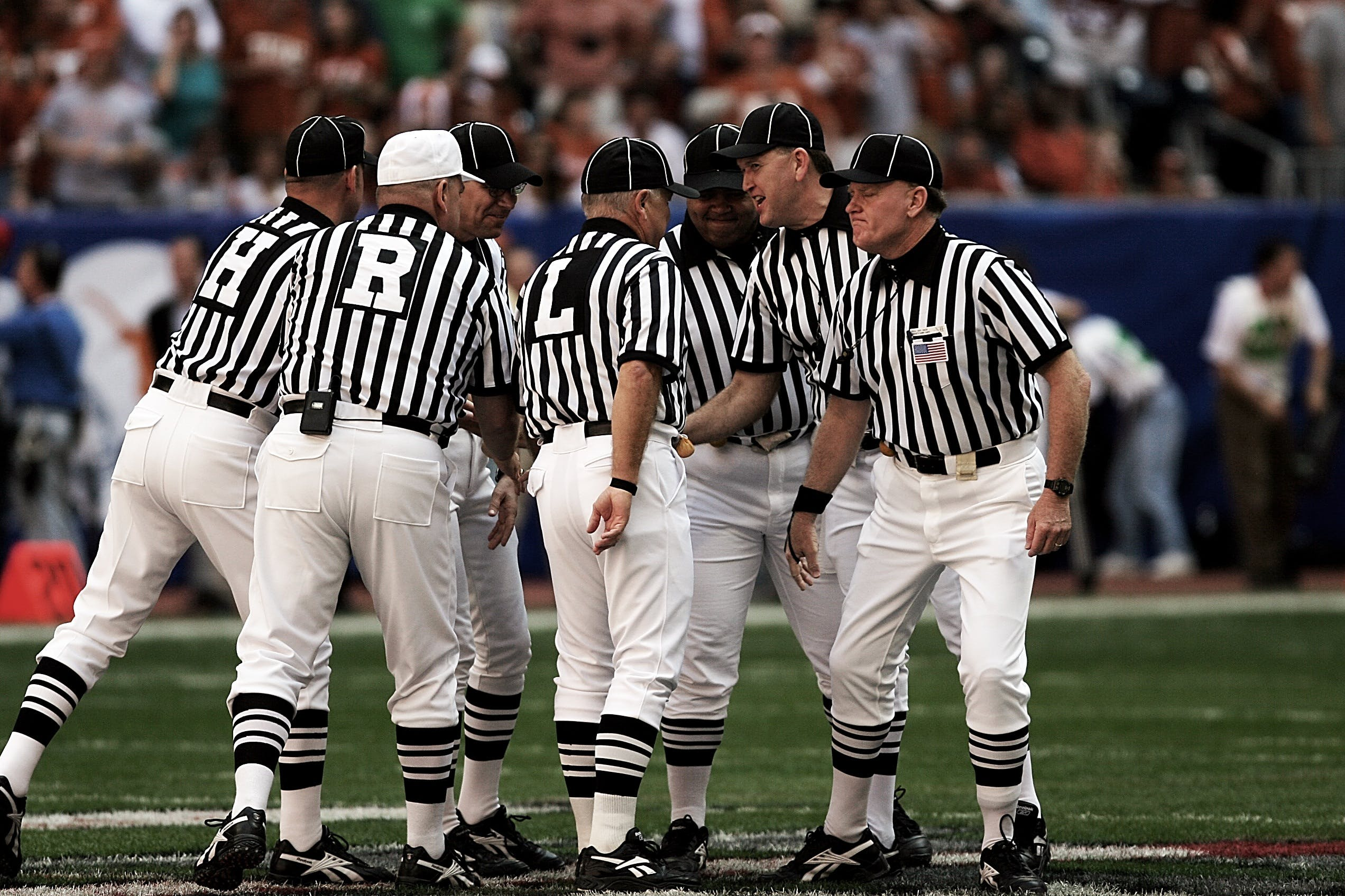 8 Football Referees in the Field