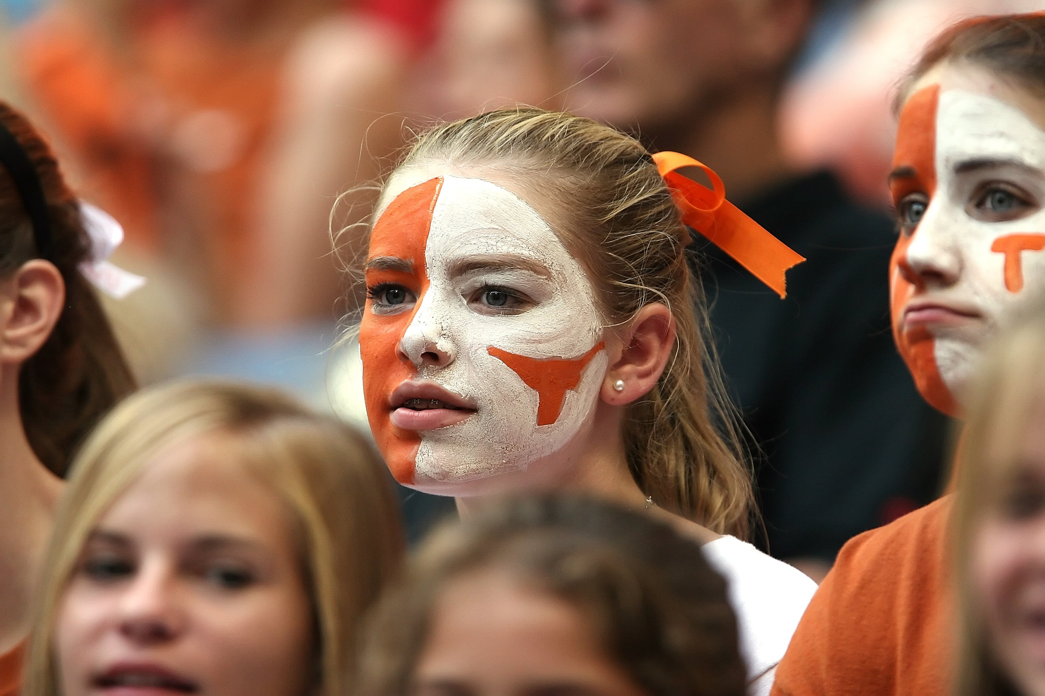 Blond Hair Woman With Orange and White Face Paint