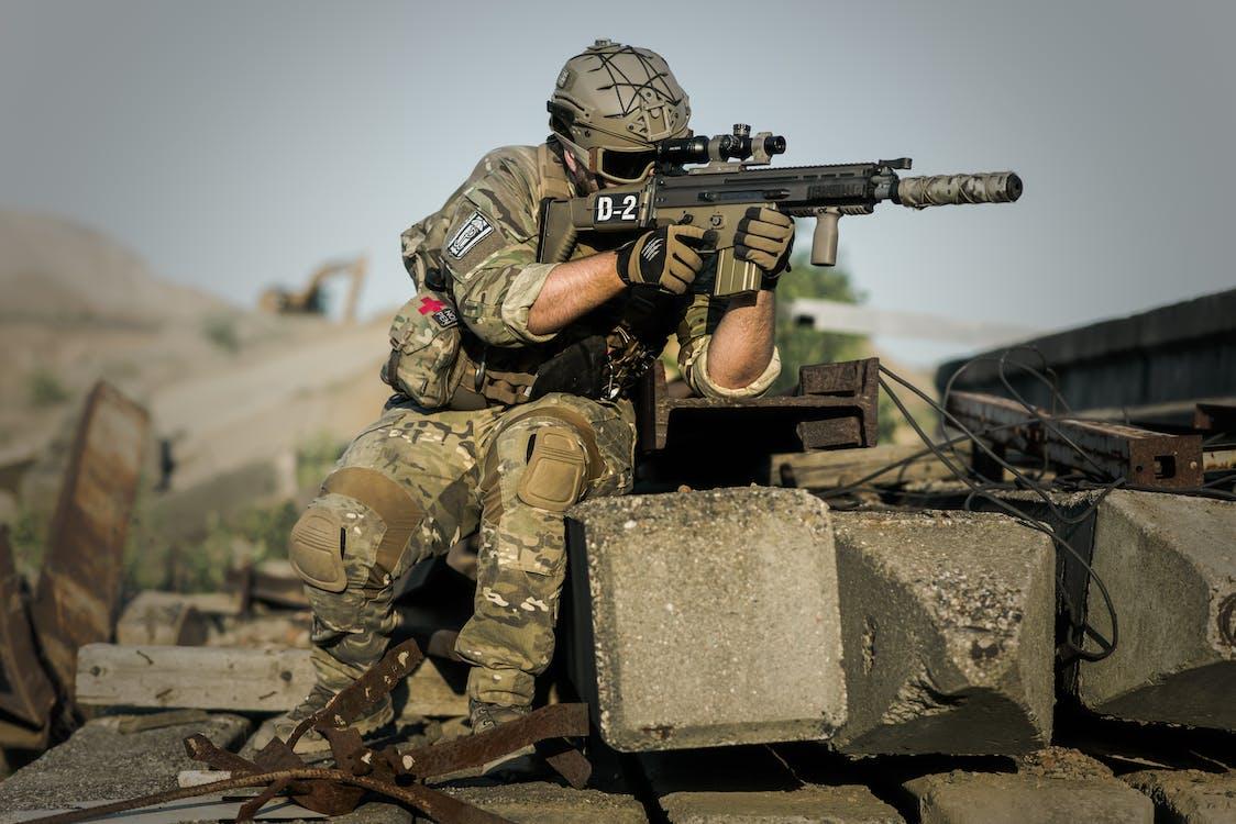 Soldier Near Concrete Pillars Holding Semi AutomPertahanan tidak hanya sebatas militer dan polisi, tetapi masyarakat dan seluruh elemen yang ada di suatu negaraatic Gun With Scope