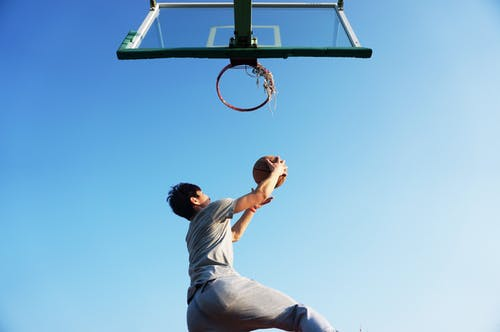 Man Dunking the Ball