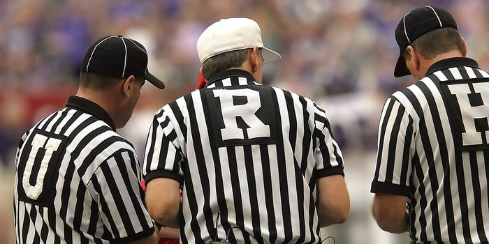 3 Referees Standing on Field