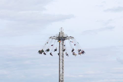 People Riding Tower Swing