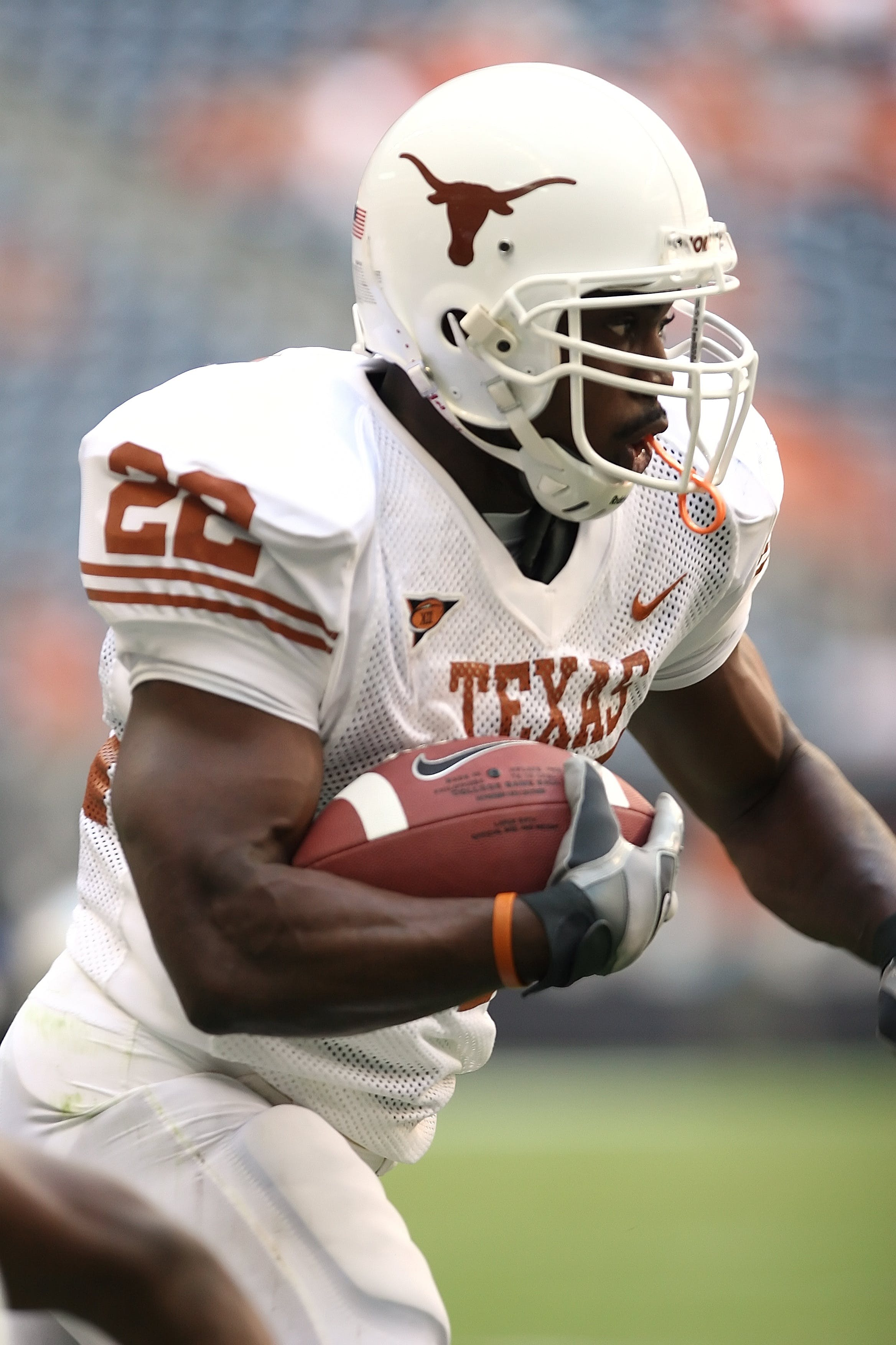 Man Wearing Texas Nike 22 Jersey Holding Ball and Running during Daytime