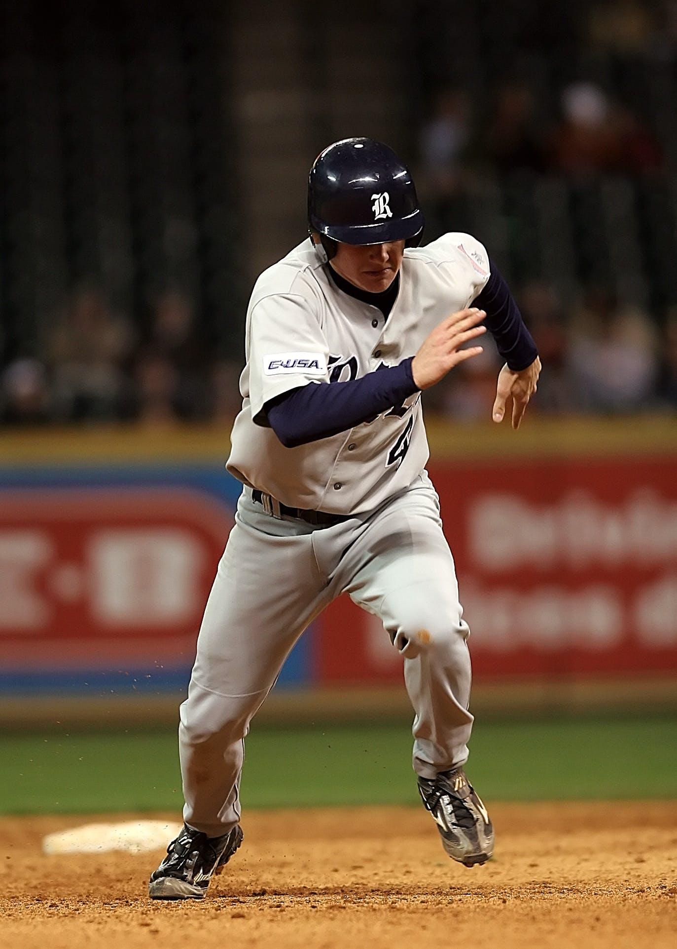 Man Playing Baseball Photo