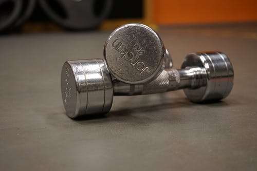 Close Up Photography of 2 Grey Dumbbell