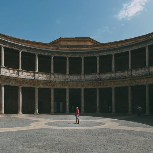 Man Walking in the Middle of Gray Palace