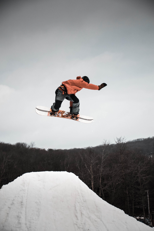 Man in Snowboard Jumping on Ramp