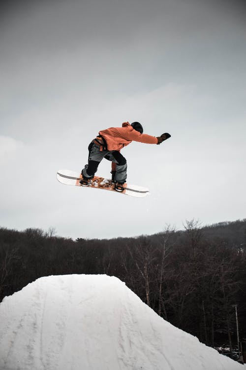 Man in Snowboard Jumping on Ramp
