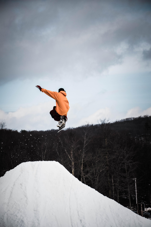 Person Snowboarding on Snow Mountain