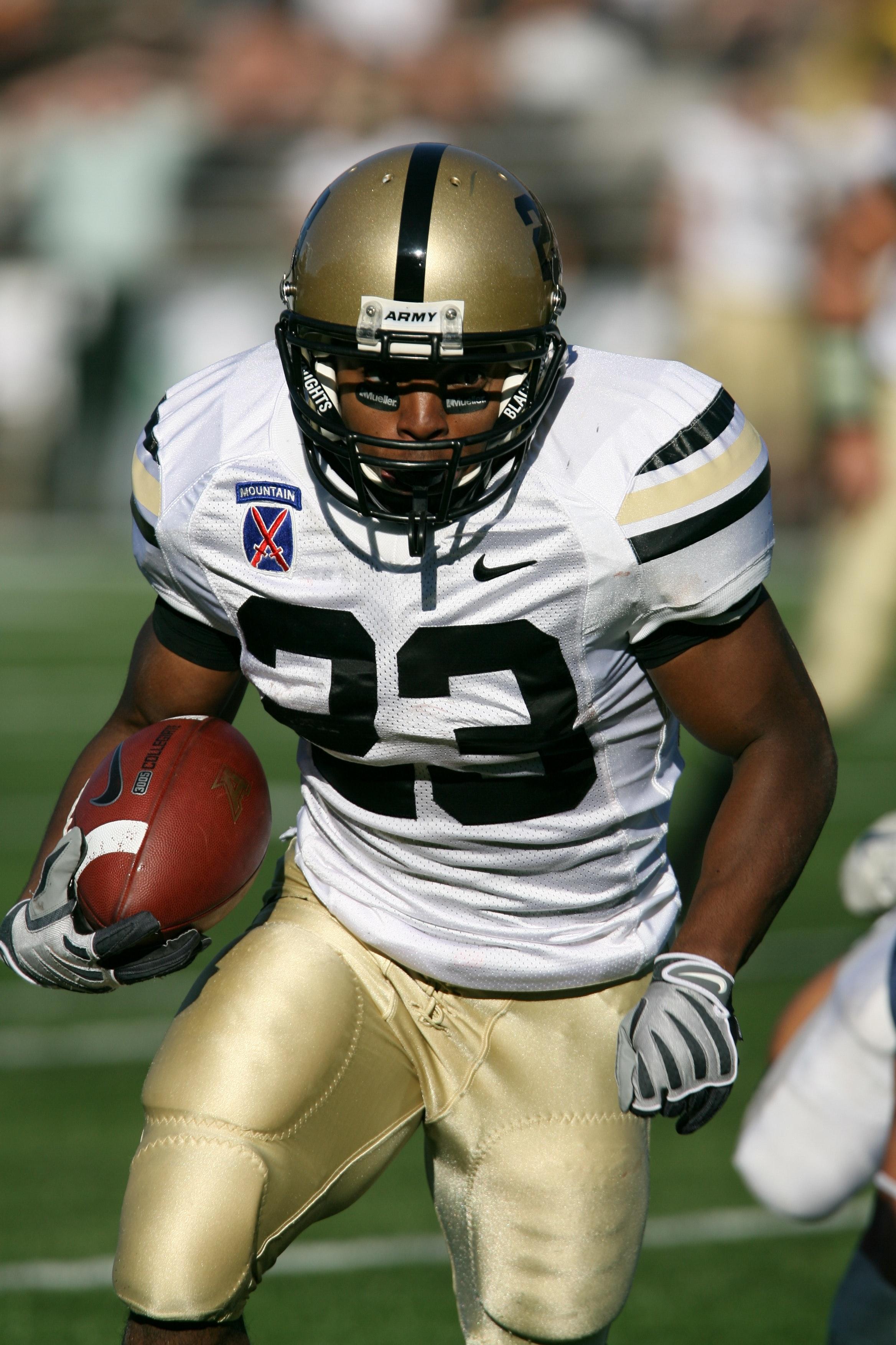 premium selection 4b716 67b67 Man Wearing White Nike 23 Football Jersey on Green Field ...