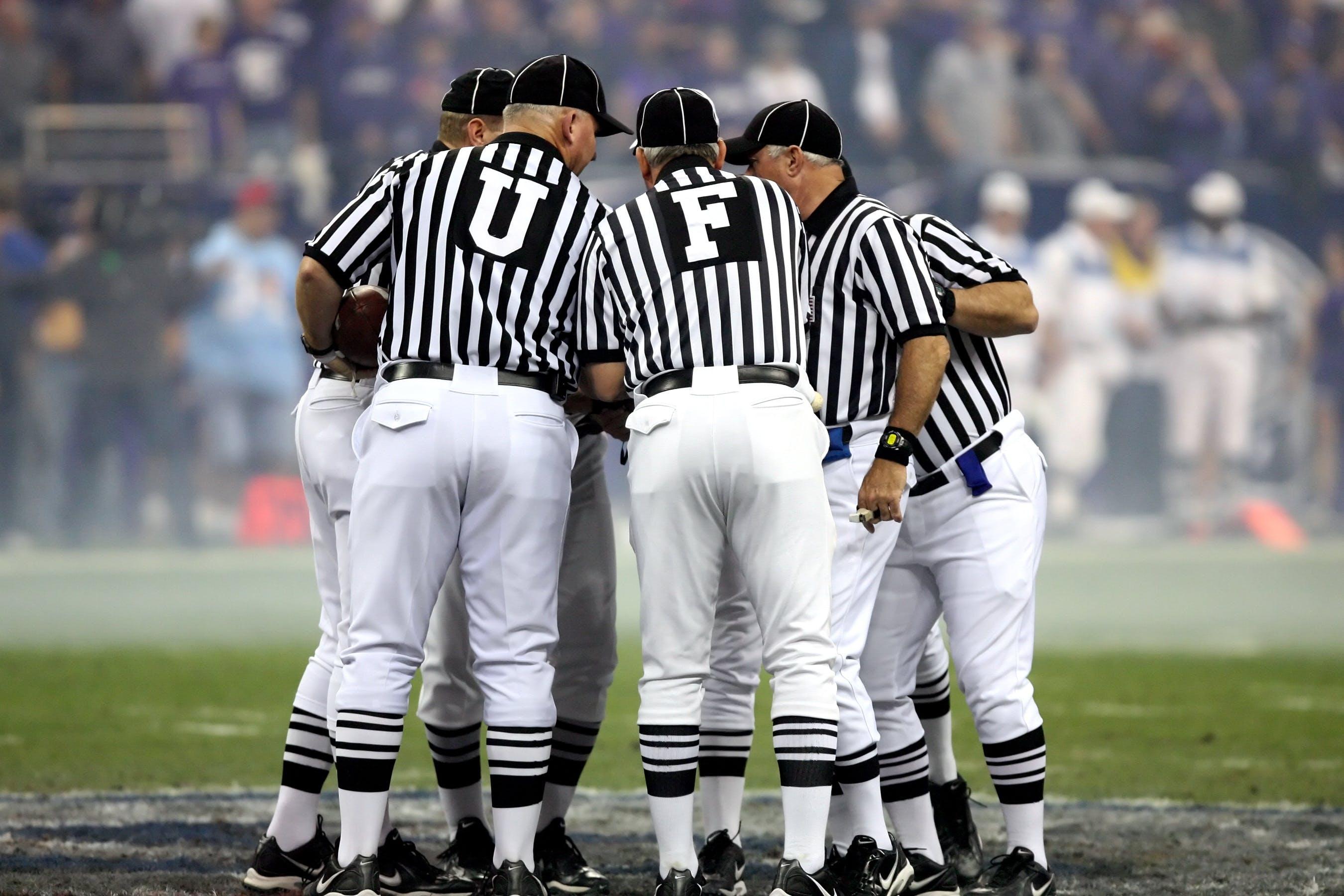Peoples Wearing Black and White Stripe Baseball Jersey Shirt on Baseball Field