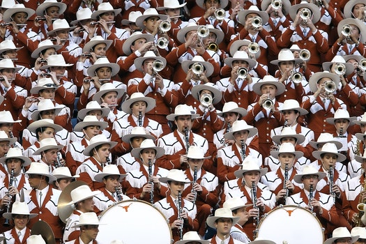 Group of People in White Hat Playing Together Different Kinds of Musical Instruments