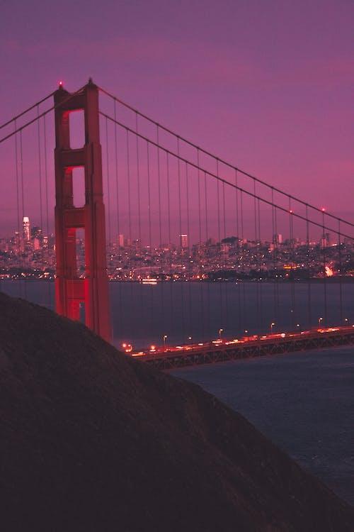 Photos gratuites de bâtiments, coucher de soleil, longue exposition, pont