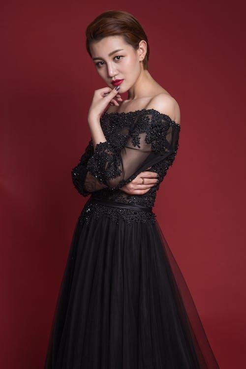 Woman in Black Strapless Dress Posing
