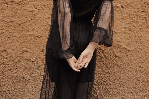 Woman Wearing Black Sheer Long-sleeved Dress