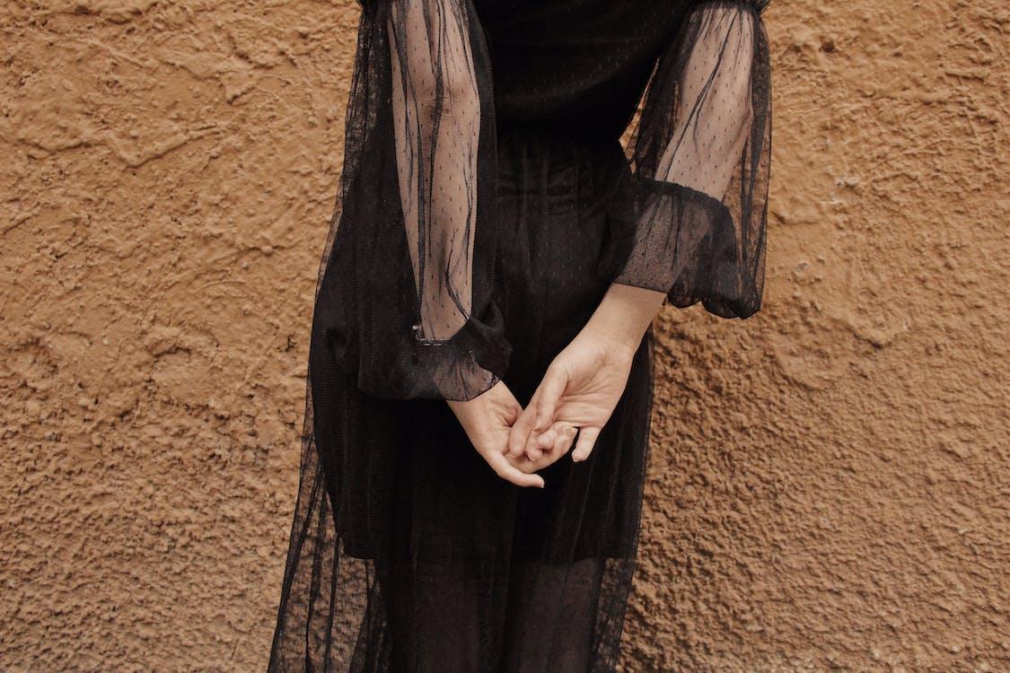 Woman Wearing Black Sheer Long-sleeved Dress