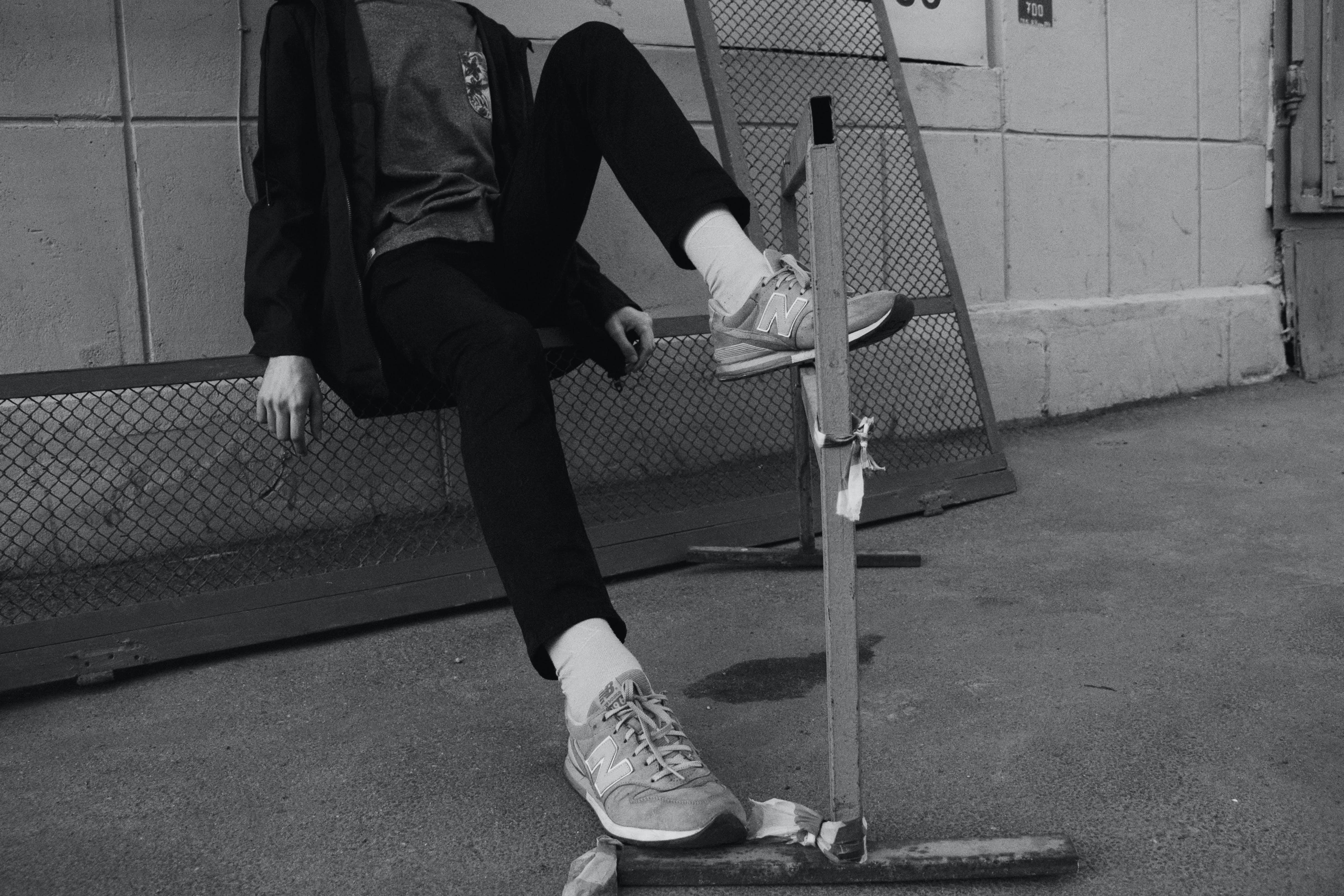 Man Sitting Down on Rails