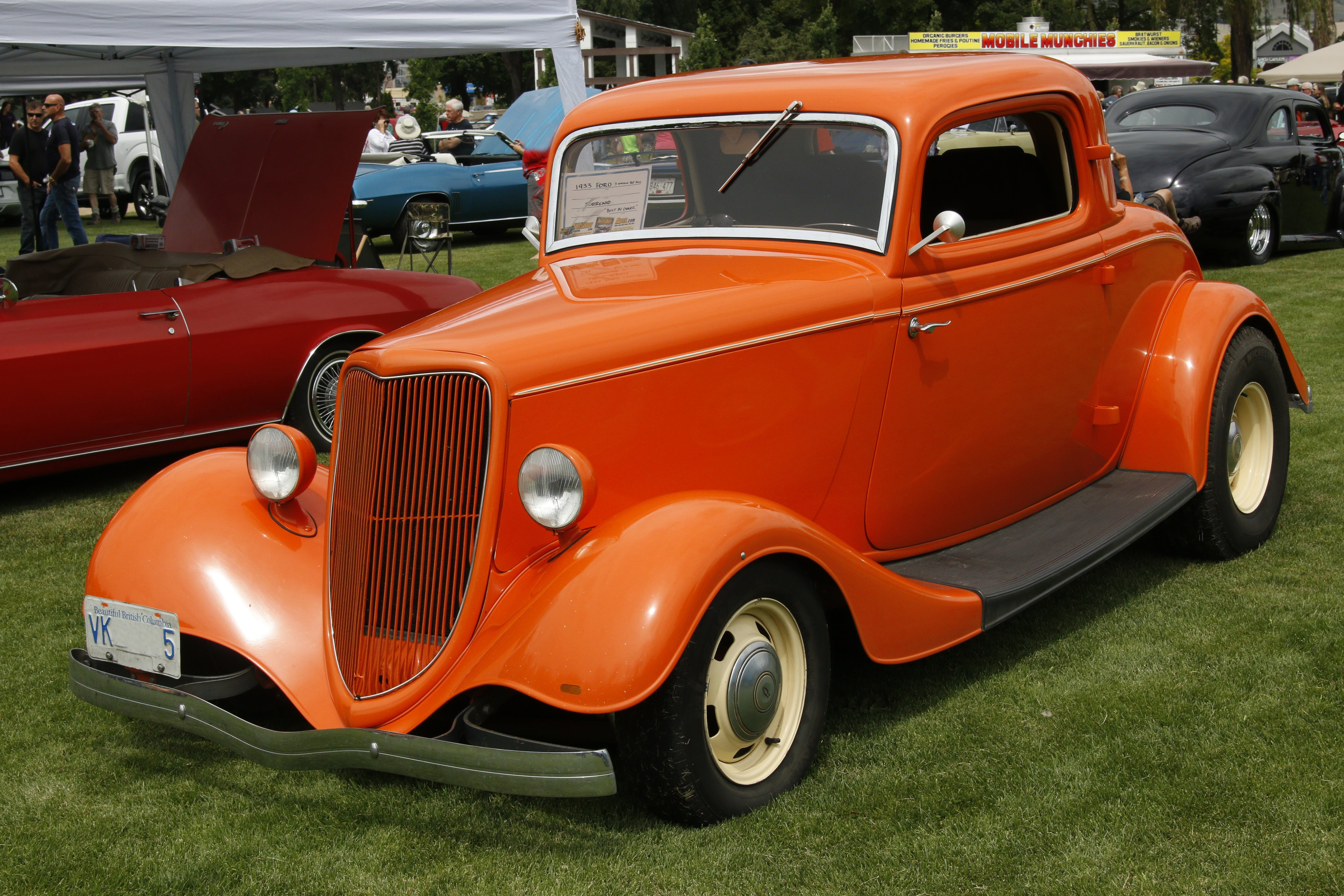 Orange Classic Coupe on Green Grass Field