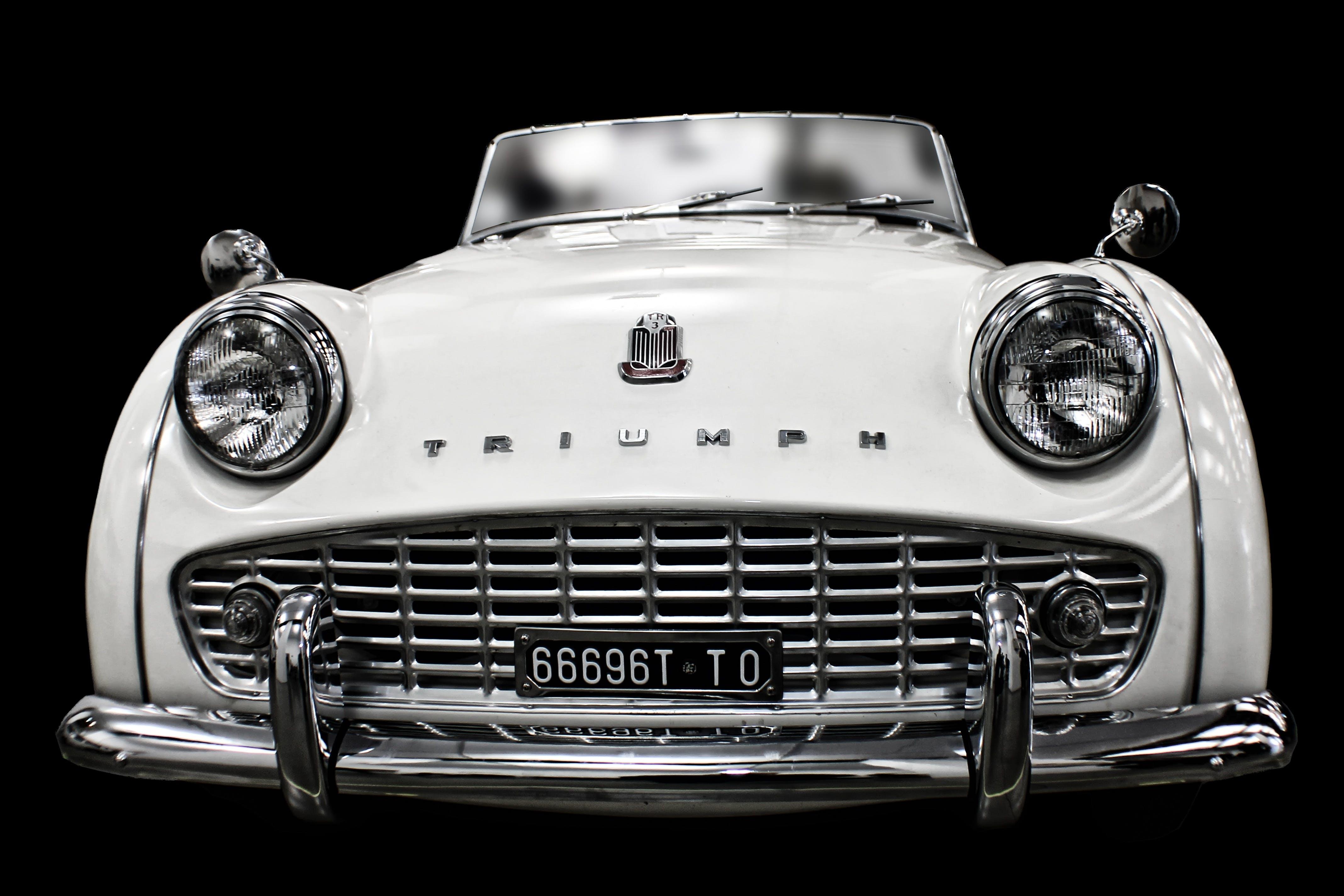 White Vintage Triump Sedan