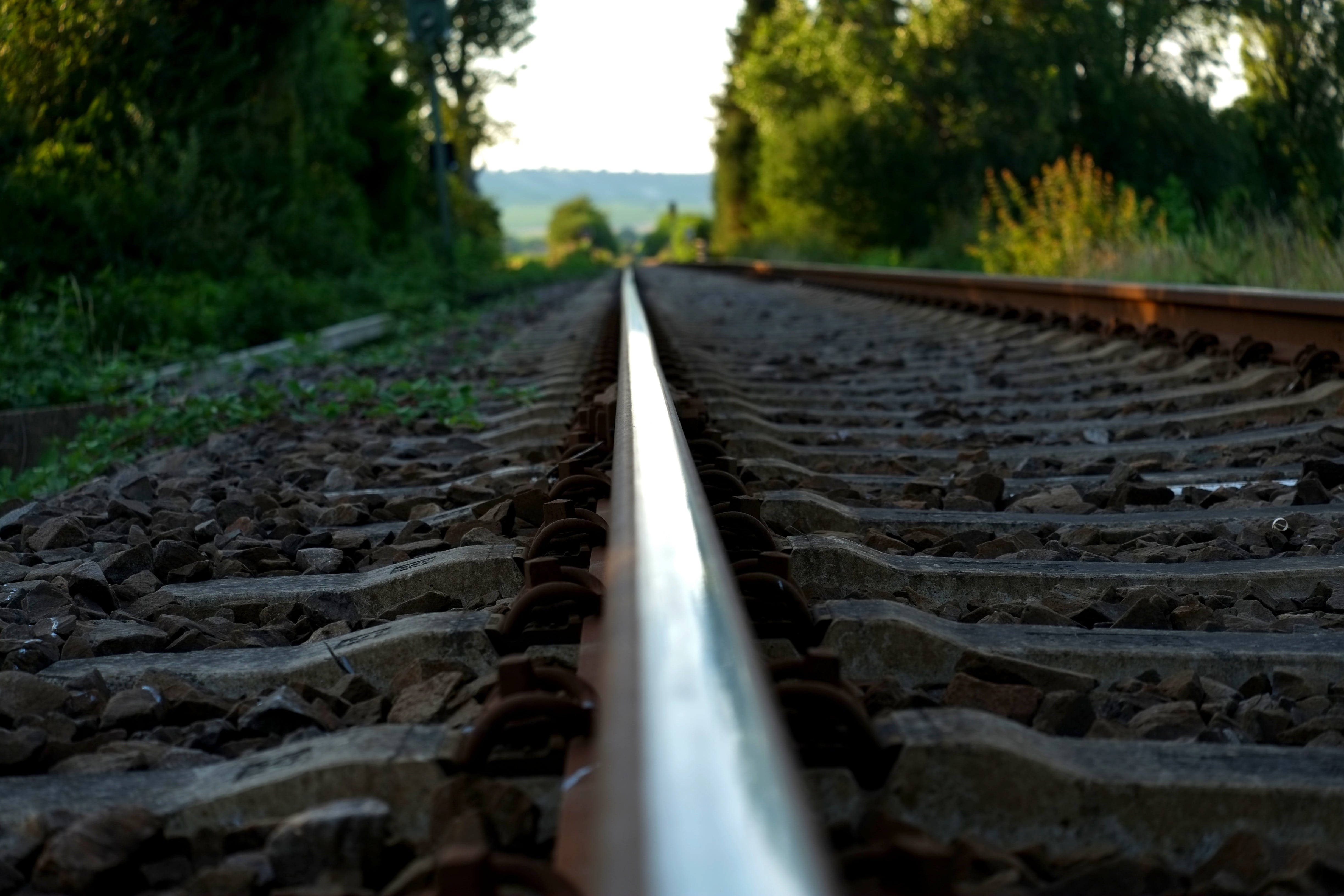 Brown Train Rail on Close Up Photo during Daytime