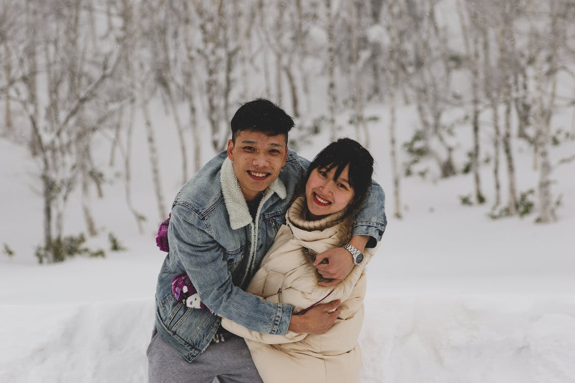 Man and Woman Embracing Each Other on Winter Outdoors