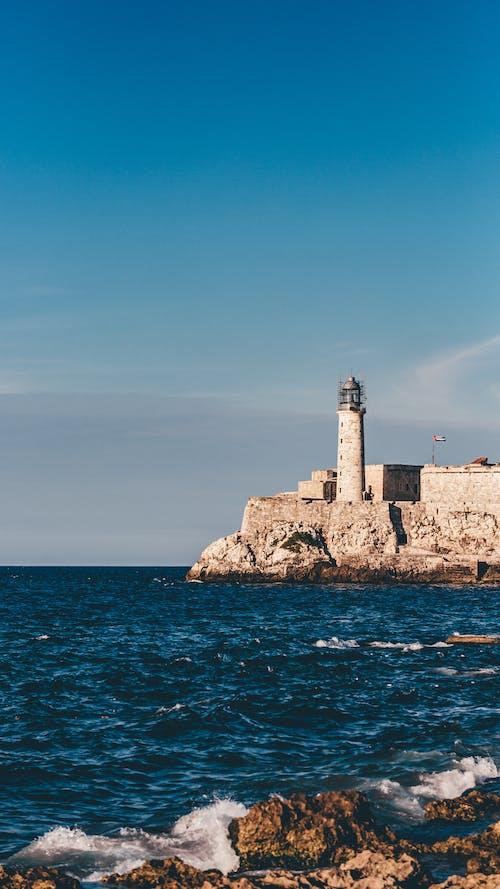 Foto d'estoc gratuïta de costa oceànica, far, oceà, paisatge