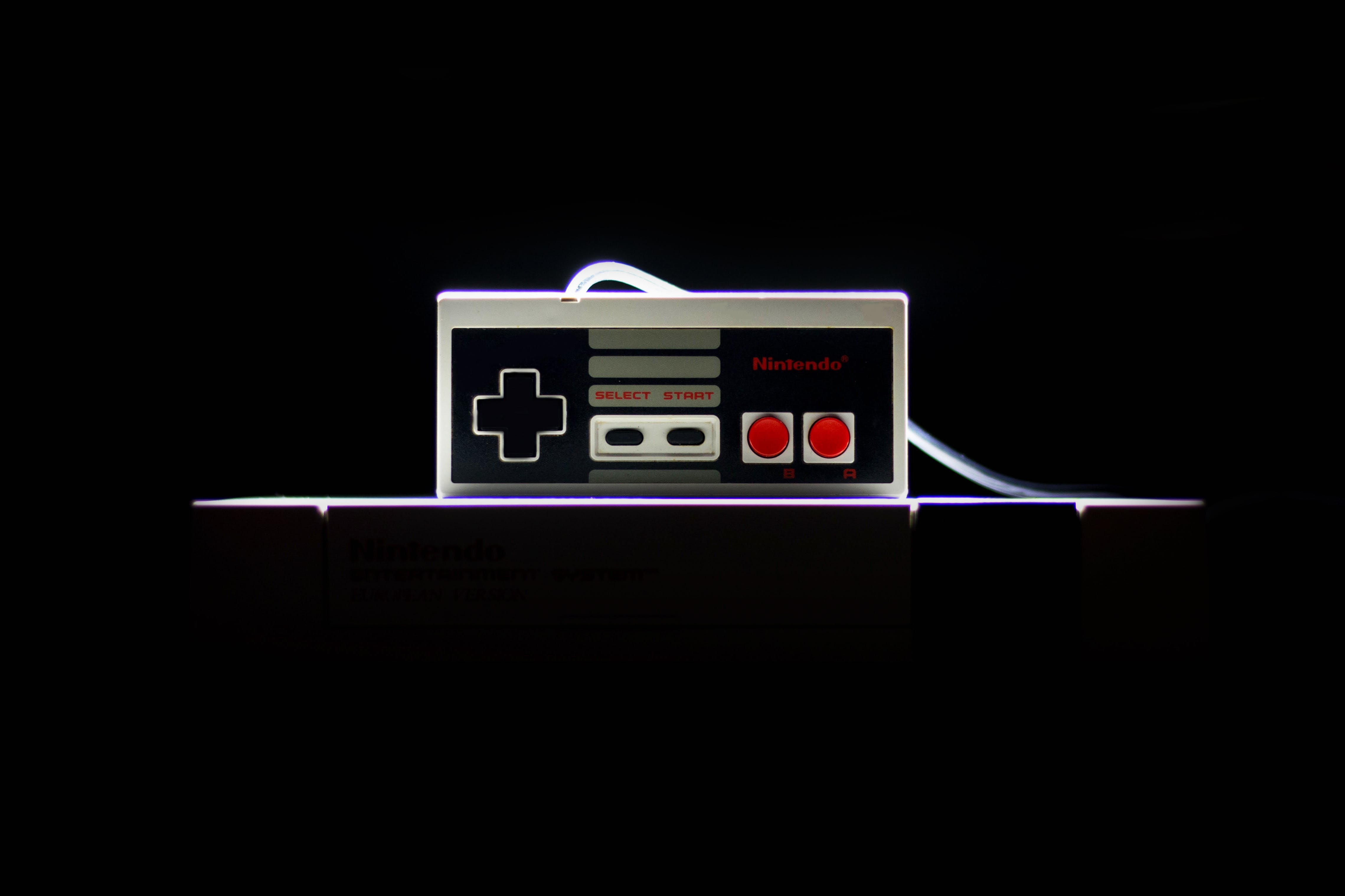 Low-light Photo Of Nes Controller