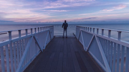 Man Standing At The Pier