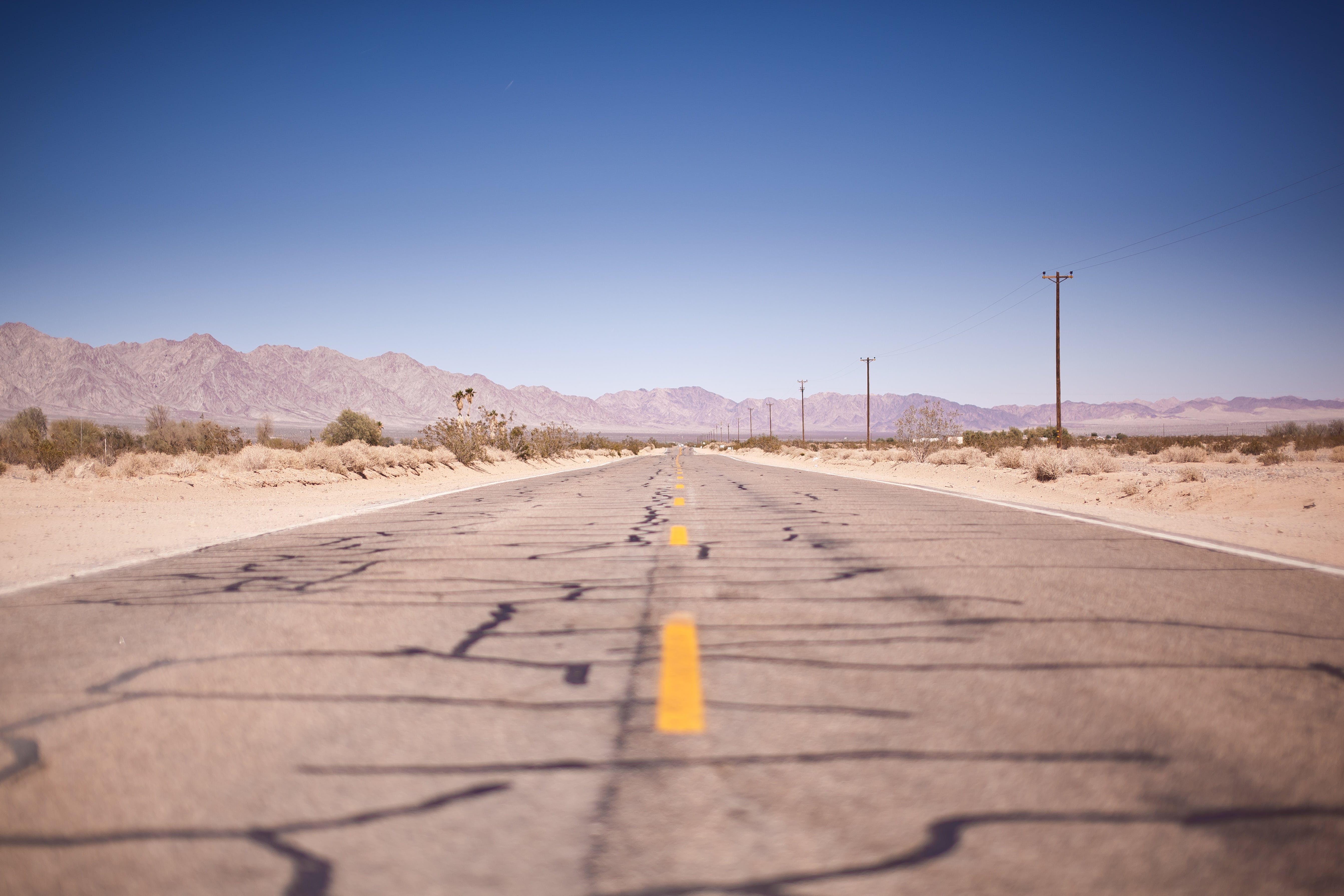 Asphalt Road Under the Clear Blue Skies during Daytime
