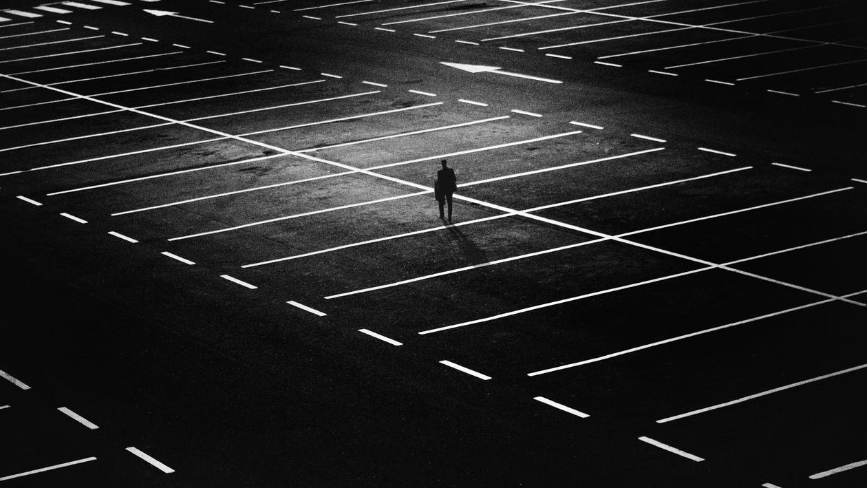 Man Standing on Parking Lot