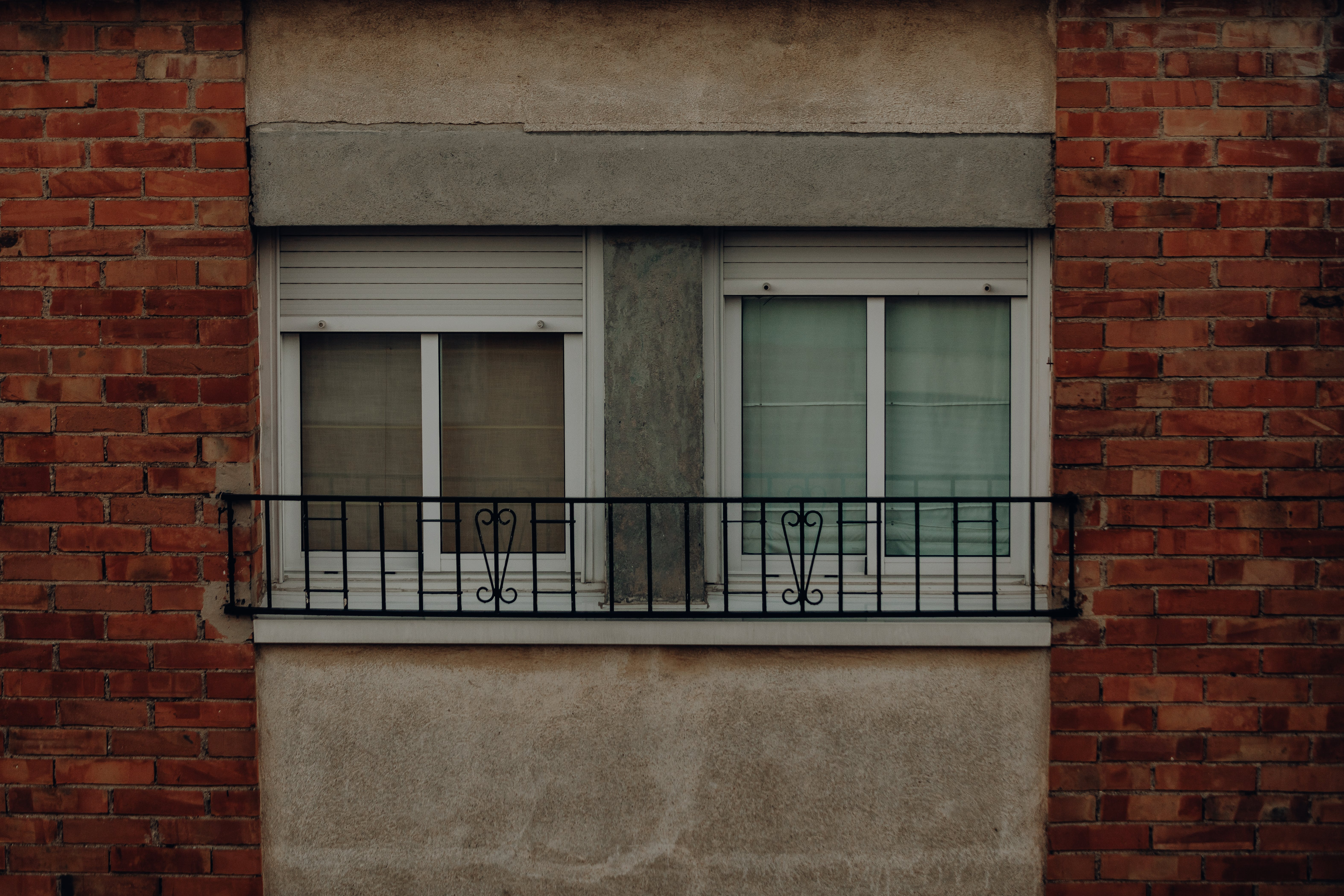 Two Closed Windows Between Walls