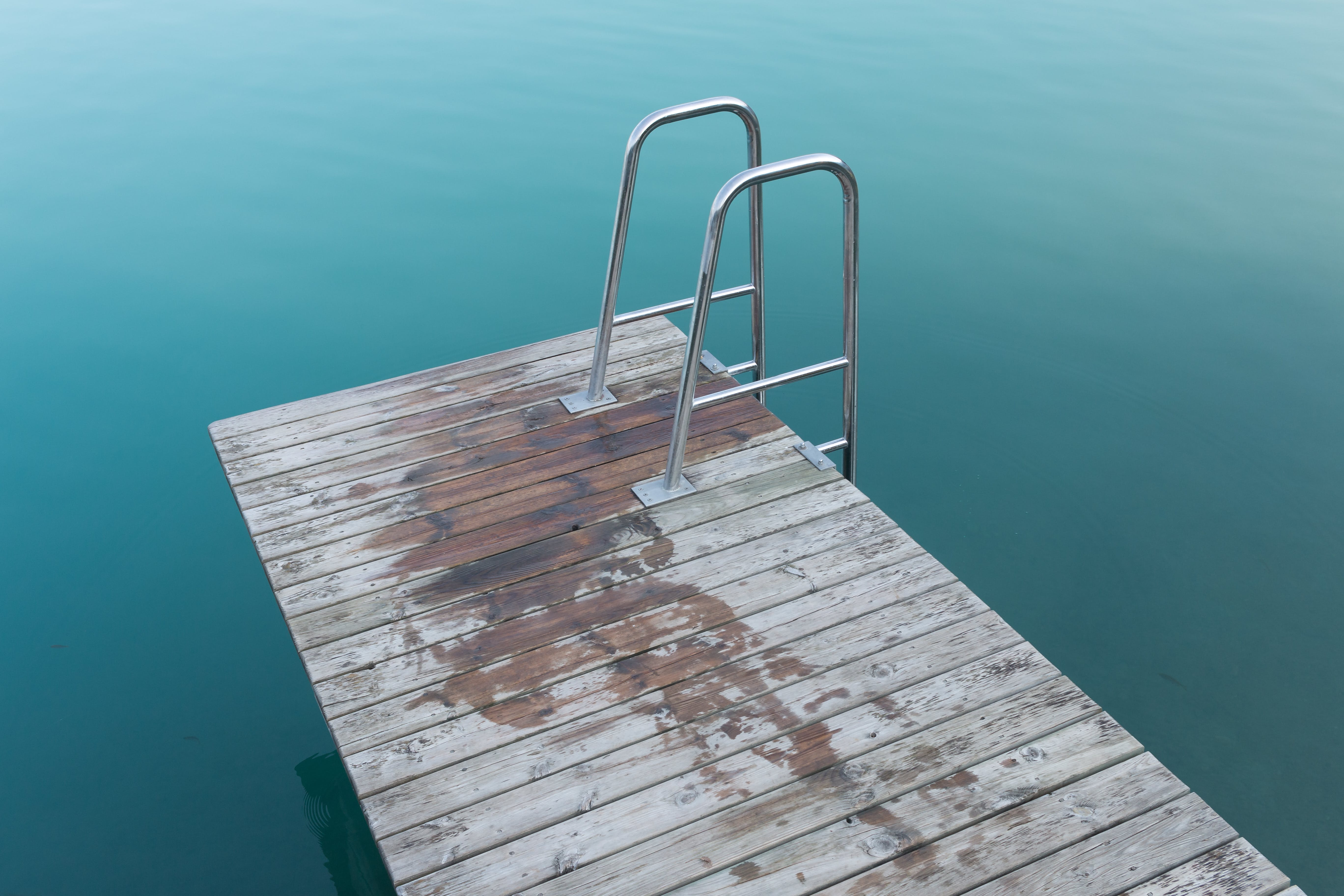 Empty Brown Wooden Dock With Ladder on Body of Water