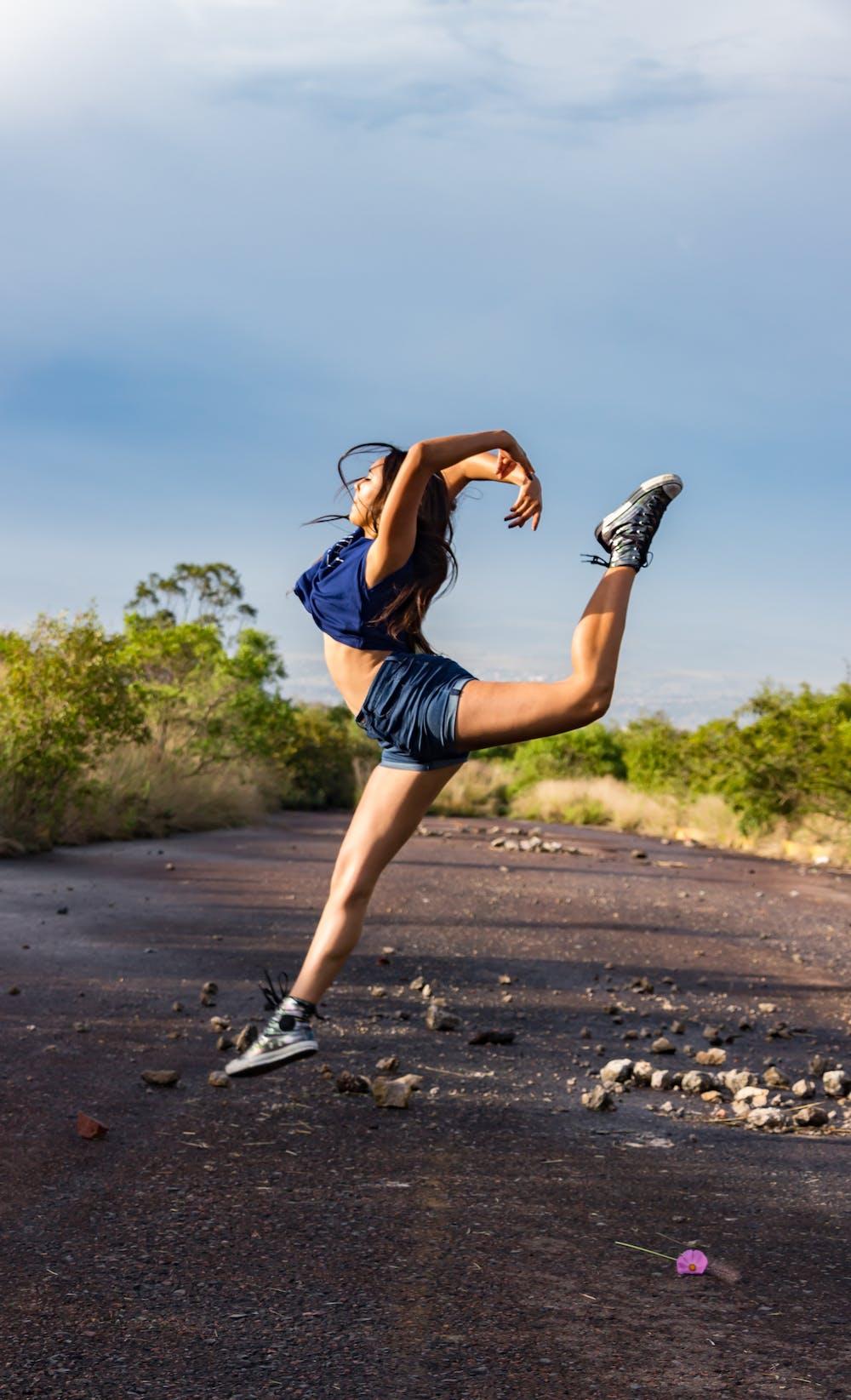 A woman wearing blue vest exercising.   Photo: Pexels
