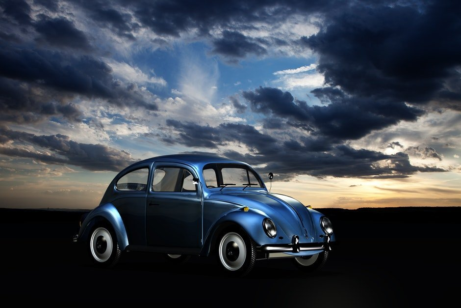 Blue Volkswagen Beetle Under Blue Sky and White Clouds during Golden Hour