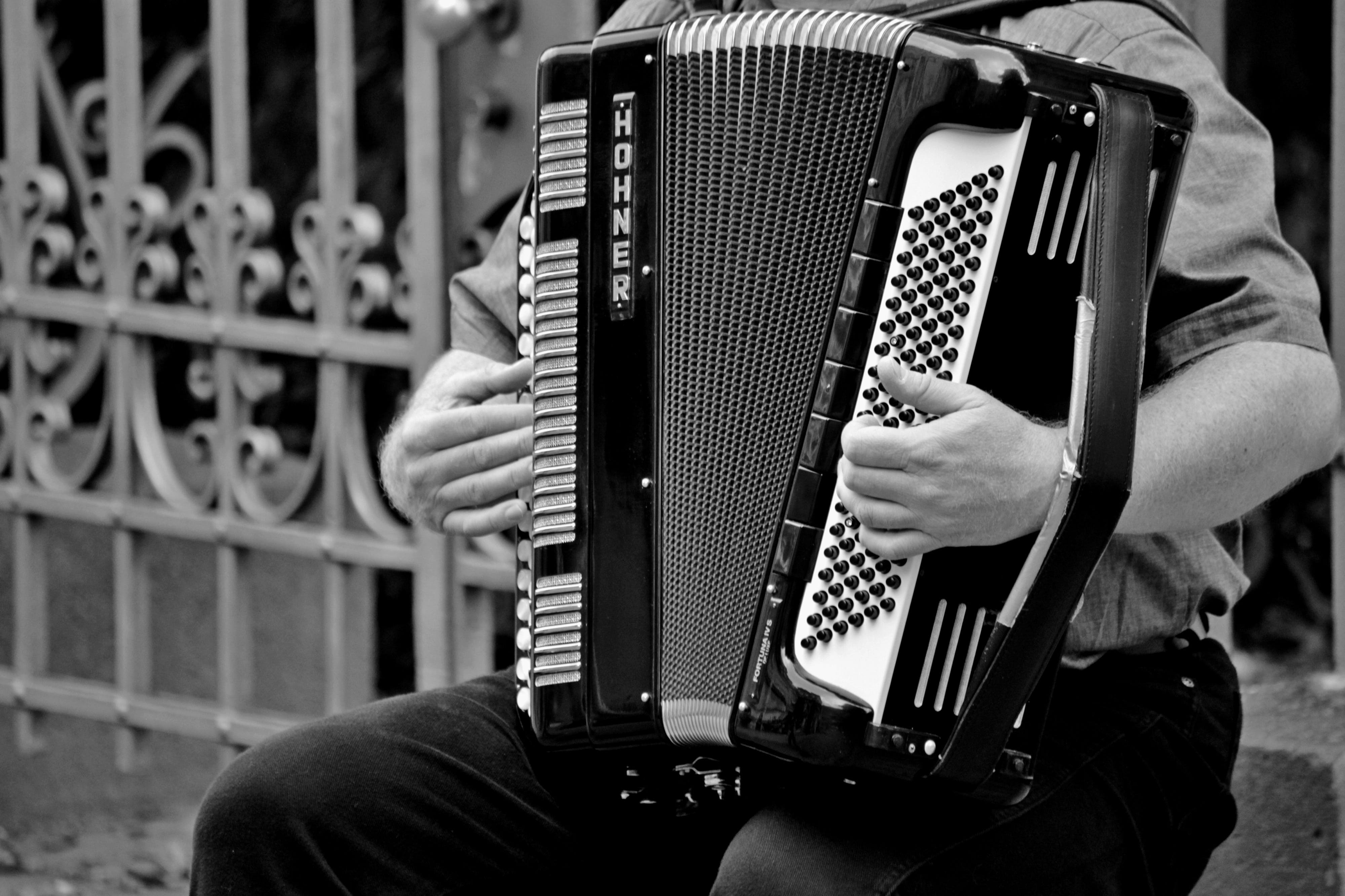 Person Playing a Horner Musical Intrument in Grayscale