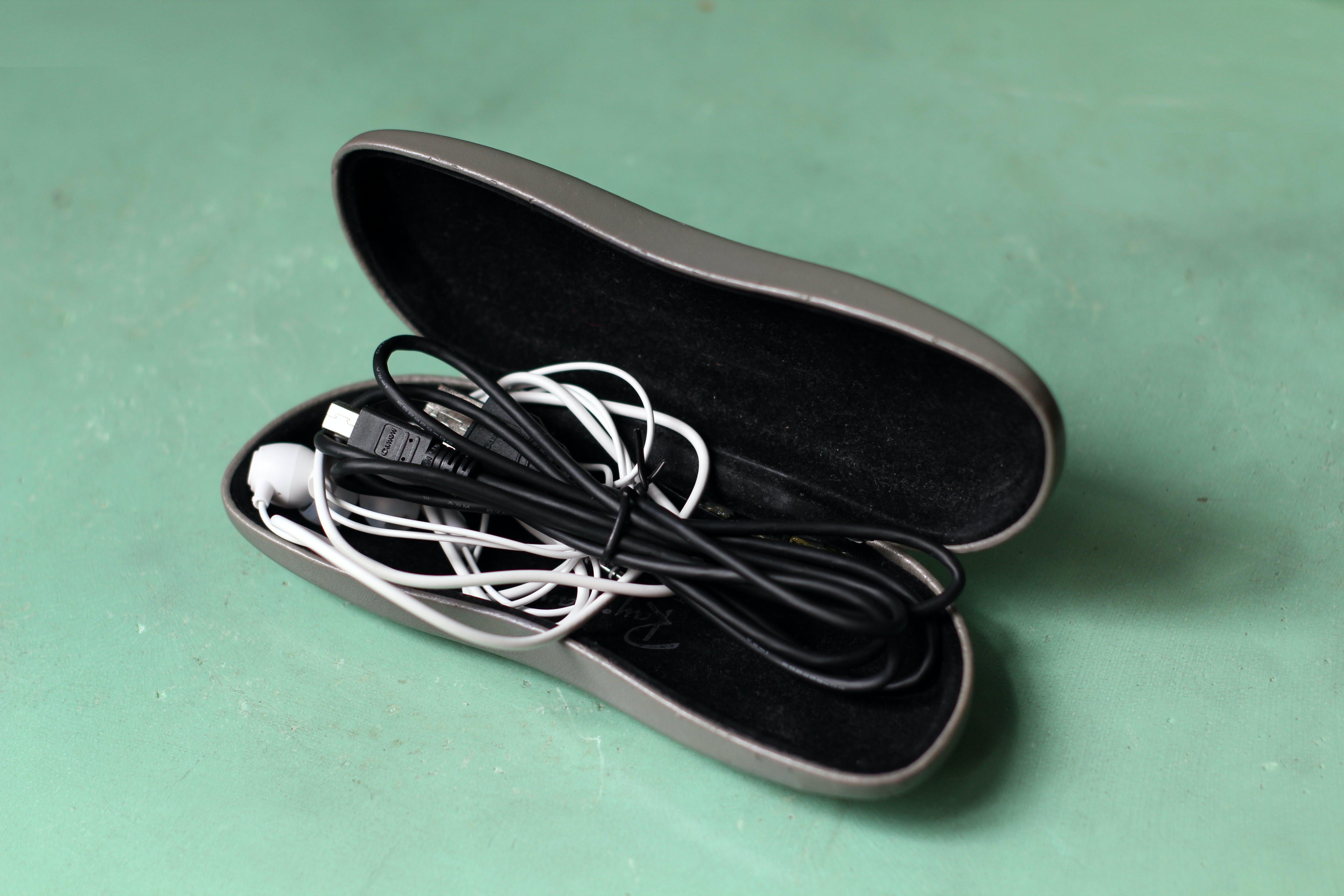 Free stock photo of Sunglasses Case Earphones Ear buds Cables