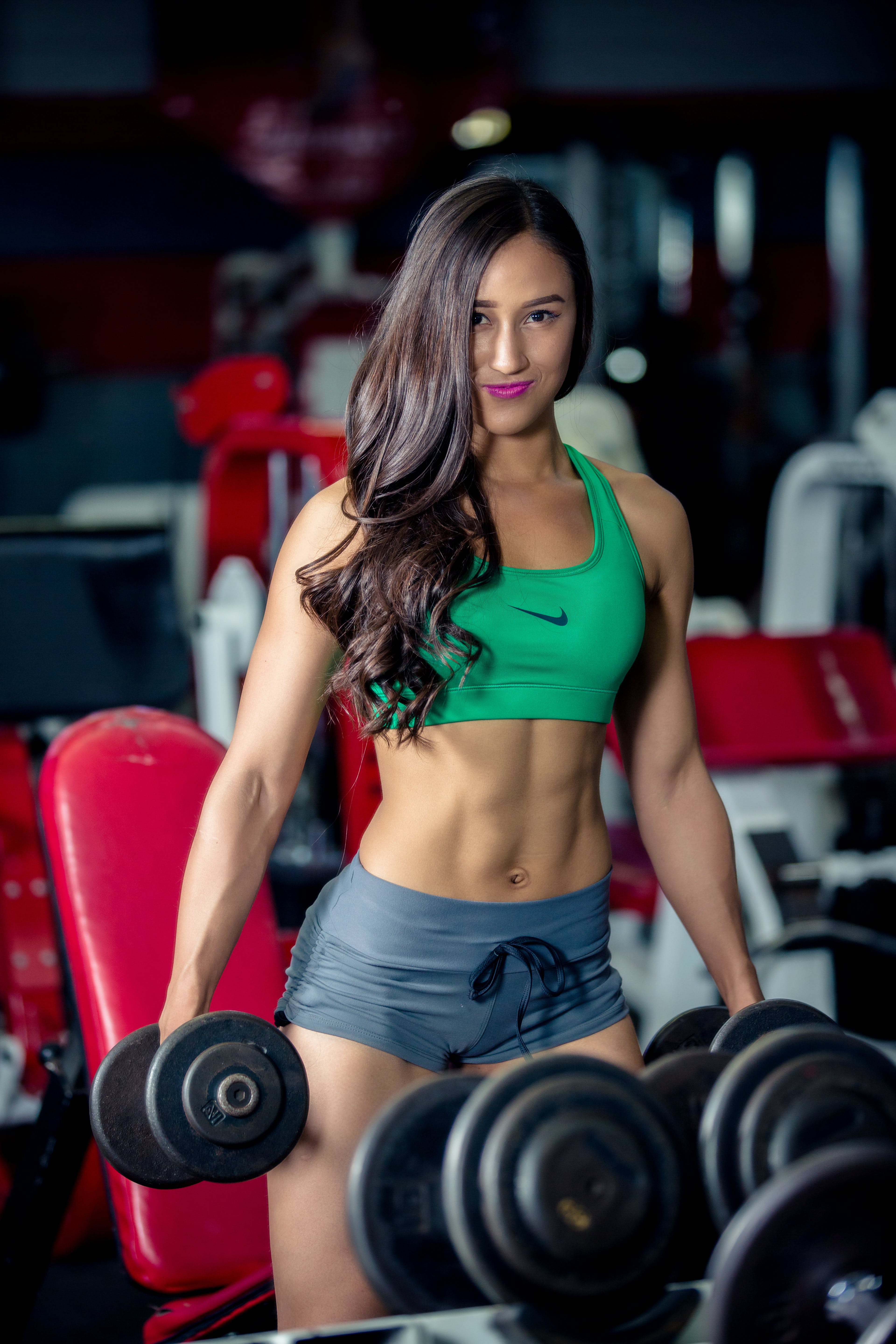 Photo of Woman Lifting Two Dumbbells